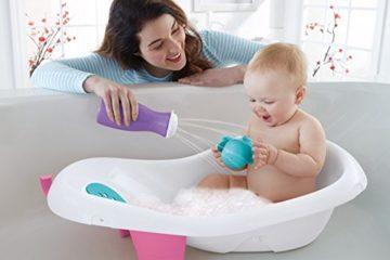 Baby playing in bath tub